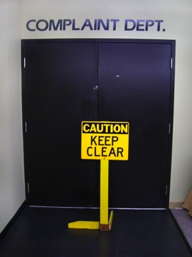Complaint Departments Entrance with Caution Keep Clear Sign